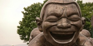 Amazing Laughter sculpture by Yue Minjun in Vancouver, BC