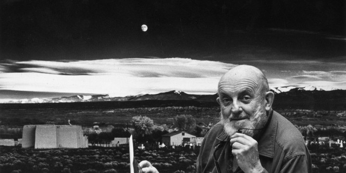 1974:  Portrait of American photographer Ansel Adams (1902 - 1984) standing in front of his landscape photograph, 'Moonrise, Hernandez,' at his home in Carmel, California. He holds a photographic print in one hand, and his eyeglasses in the other.  (Photo by Joe Munroe/Hulton Archive/Getty Images)